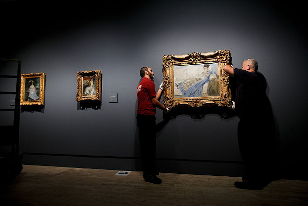 Gallery technicians install Pierre Auguste-Renoir's work 'Portrait of Madame Claude Monet', painted in 1874 and borrowed from the Museu Caloueste Gulbenkian.