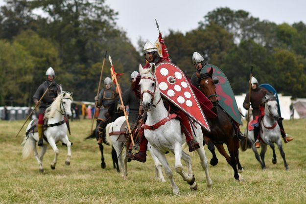 A re-enactor depicting William the Conqueror rides onto the battle field.