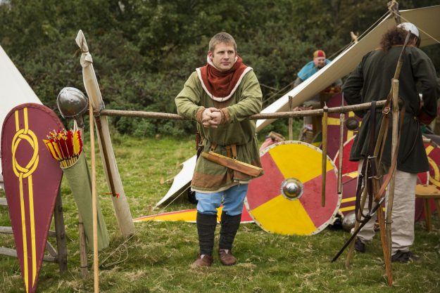 A re-enactor in the Saxon Camp relaxes before a the battle.
