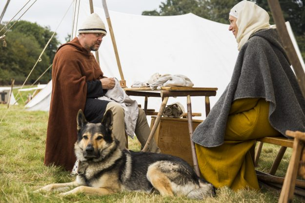 Re-enactors from the Norman camp rest before the battle.