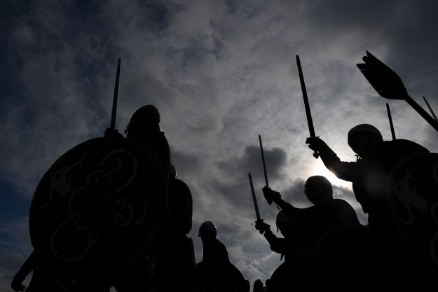 Soldiers raise their swords during the re-enactment of The Battle of Hastings.