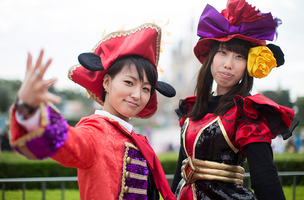 Visitors dressed as Disney characters pose for a photograph during the Disney's Halloween 2016 event.
