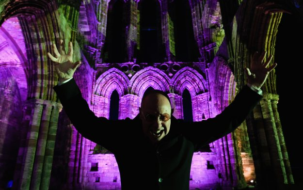 Actor Richard Hollick poses for a picture as he prepares to play Dracula during a performance at the spectacular light display during illuminations at the historic Whitby Abbey.