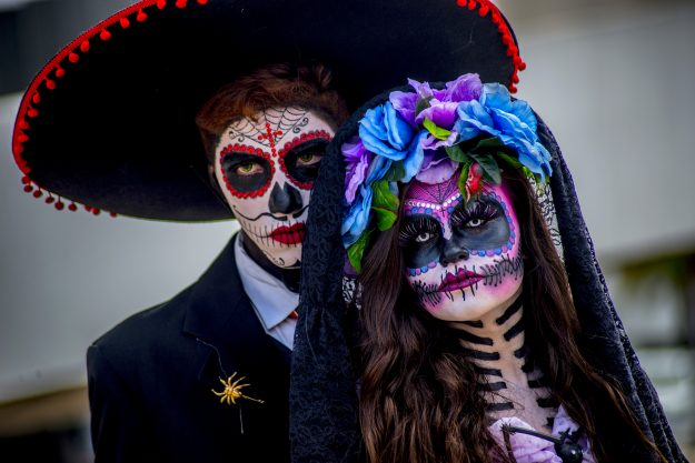 People in costume wait to parade during the Dia de los Muertos (Day of the Dead) festival at the Memorial da America latina in São Paulo, Brazil.