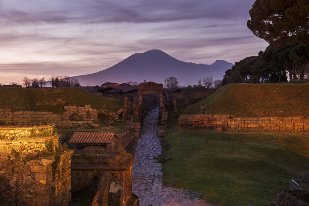 Italy, Campania, Pompeii, Landscape with ancient ruins and Mount Vesuvius in background.