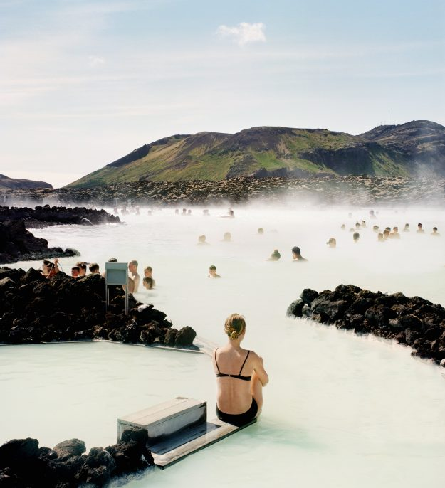 Sitting on the edge of a Scandinavian geothermal blue lagoon is very hygge. Image: Muriel de Seze/Getty Images