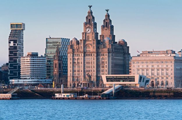 The Liver Building and Pier Head viewed across the River Mersey, Liverpool, England.