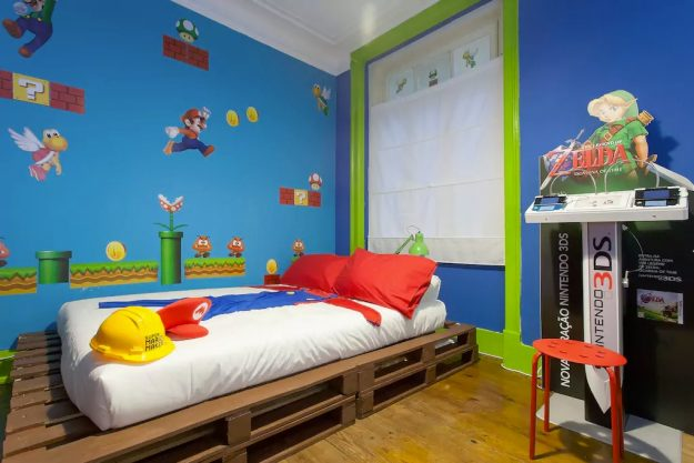 The themed room has a Super Mario bedspread and other decorations. You can stay in this amazing Super Mario themed Airbnb in Lisbon