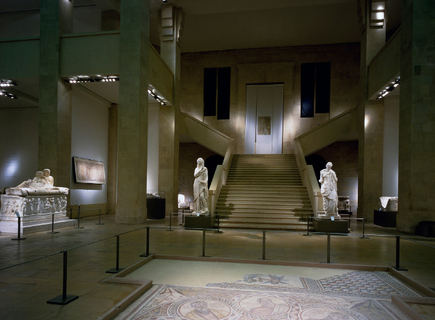 Roman statues and sarcophagi at the National Museum of Beirut.