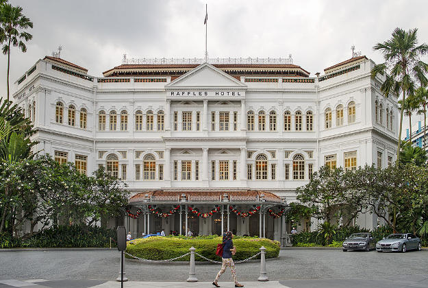 A view of the colonial style Raffles Hotel from the front entrance of the building.