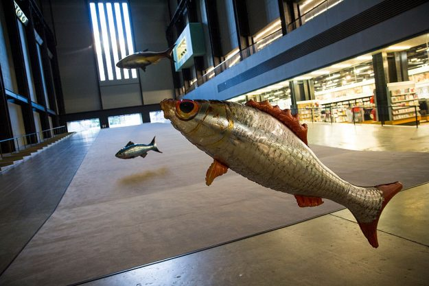 Inflatable fish float during a photo call for a new installation by French artist Philippe Parreno, Tate inflatable fish