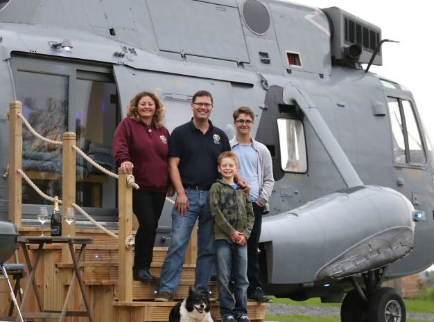 The Steadman family outside the converted helicopter