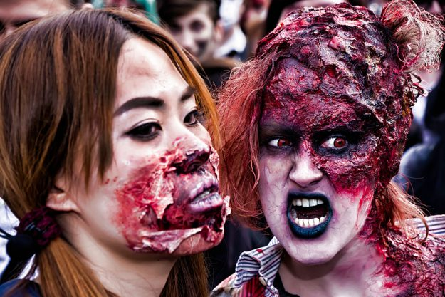 Participants dressed as zombies wander through the streets in Paris during World Zombie Day on October 8.