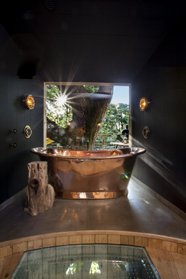 A double ended copper bath in the treehouse.