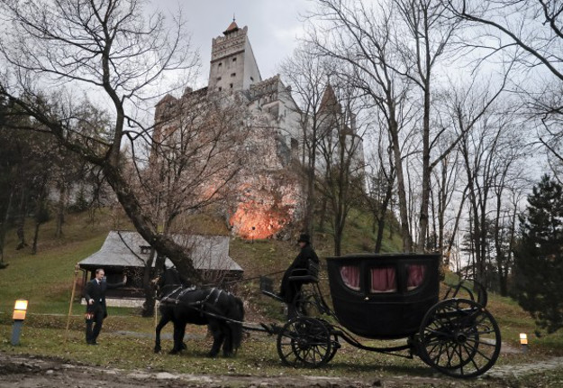 A Canadian brother and sister are passing Halloween night curled up in red velvet coffins in the Transylvanian castle that inspired the Dracula.