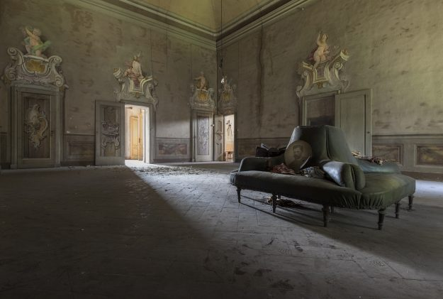 A once decadent dust covered space with cherubs on the wall seen in Northern Italy.