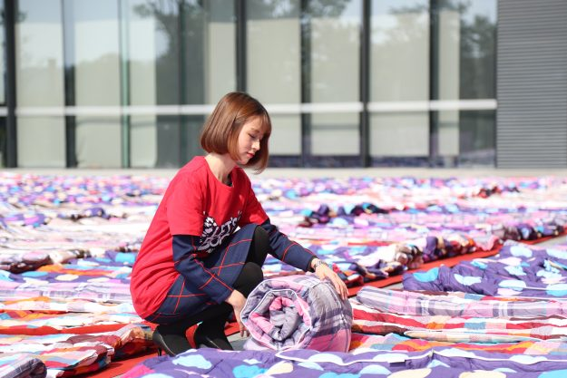 3000 quilts are aired in the sun ahead of China's forthcoming 'Bachelor Day.' Image: ImagineChina