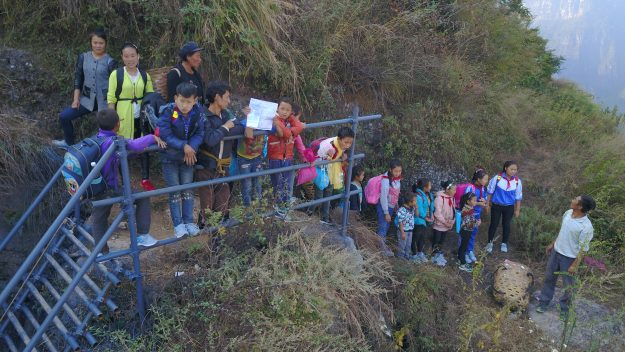 A steel ladder creates a safer path for cliff village children in China. Image: imaginechina