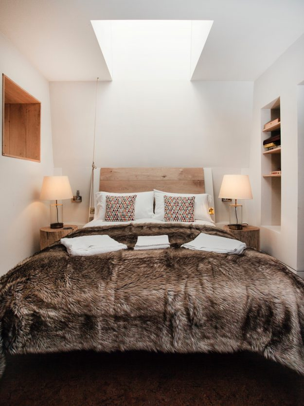 The bedroom has a skylight for views of the canopy.