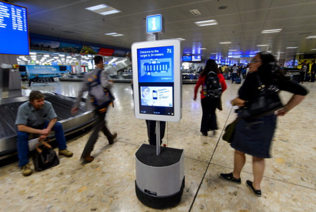 A robot helps passengers to find their way on June 13, 2013 a the baggage claim area of Geneva International Airport.