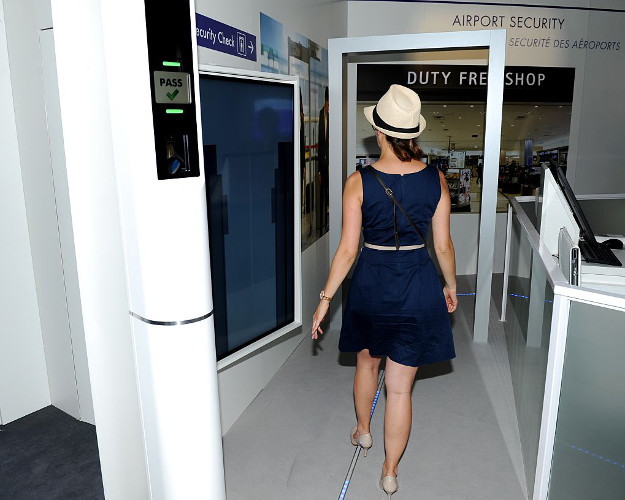 A visitor tries French manufacturer Thales'border control system with automated biometric at the International Paris Airshow at Le Bourget on June 17, 2015.