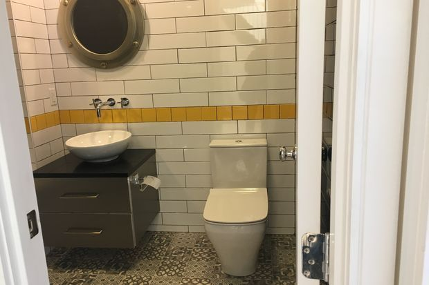 The subway theme carries through to the bathroom.