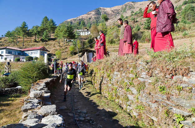 Monks line the route to watch competitors in the Everest Trail race.