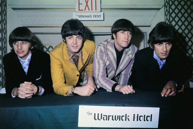 The Beatles at a press conference at the Warwick Hotel. (l-r) Ringo Starr, Paul McCartney, John Lennon and George Harrison. Image: Bettmann via Getty Images