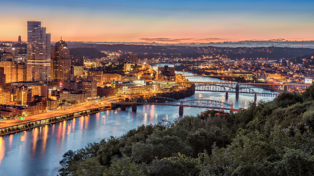 The downtown skyline of Pittsburgh, Pennsylvania as seen from Mount Washington at sunrise.