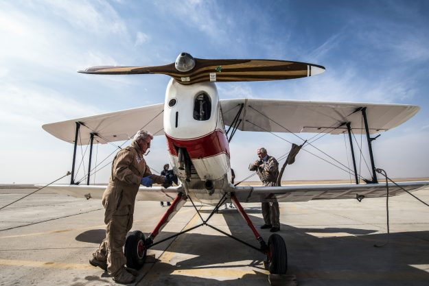 German pilot Ingo Presser checks his Bü 131 Bücker Jungmann biplane after landing at an airfield in Cairo's 6th of October City, west of the Egyptian capital, during the Vintage Air Rally.
