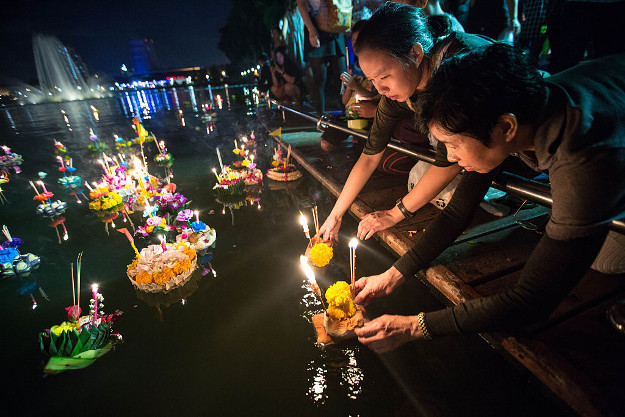 Women release 'Kratong' as people gathers at Benjakitti Park to marks Loy Kratong Festival.