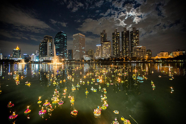 A general view of the Benjakitti Park with the full moon behind the skyscrapers as people gathers to marks Loy Kratong Festival under Biggest Full Moon since 1948, in Bangkok, Thailand on November 14.
