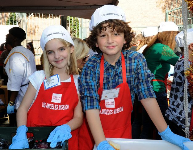 Actress McKenna Grace and actor August Maturo at the Los Angeles Mission Thanksgiving Meal For The Homeless in California. Image: Albert L. Ortega/Getty Images