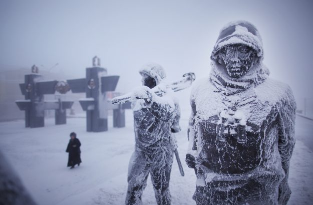 Ice crusted statues in a park commemorating the fallen of WWII in Yakutsk.