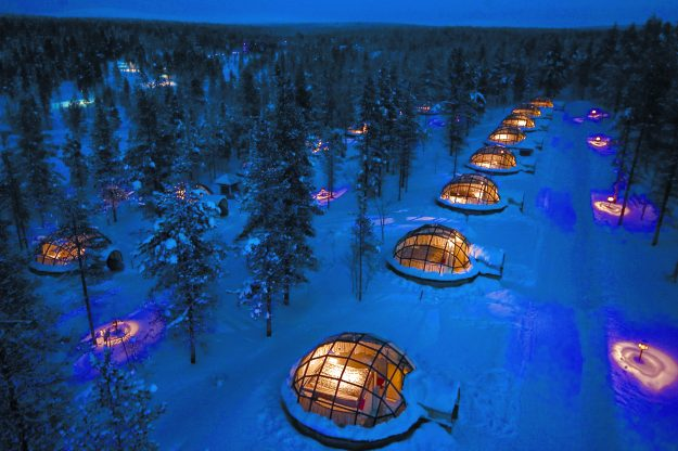 A view of the igloos lit up at night.