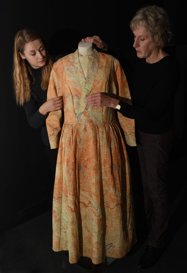 BRITISH LIBRARY CONSERVATORS INSTALLNIG A LATE 1940S DRESS MADE FROM SILK MAPS. ON DISPLAY AT THE BRITISH LIBRARY'S MAPS AND THE 20TH CENTURY:DRAWING THE LINE WHICH OPENS NOVEMBER 4TH. PHOTO CLARE KENDALL. 20/10/2016