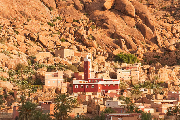 View of red mosque in the village of Adai, just outside Tafraout (or Tafraoute) at sunrise in Morocco.