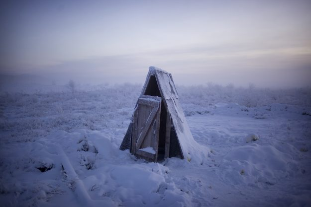 A toilet on the tundra at a petrol stop on the road to Oymyakon.