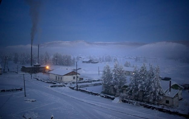 Oymakon village at dawn. The heating plant and its constant plume of coal smoke at left.