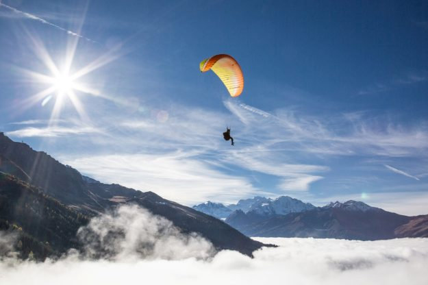 Activities include paragliding, test driving an Aston Martin and dog sledding in the Alps.