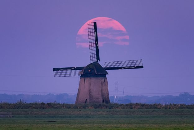 A supermoon and a windmill taken with Sony's 70-200 G Master lens.