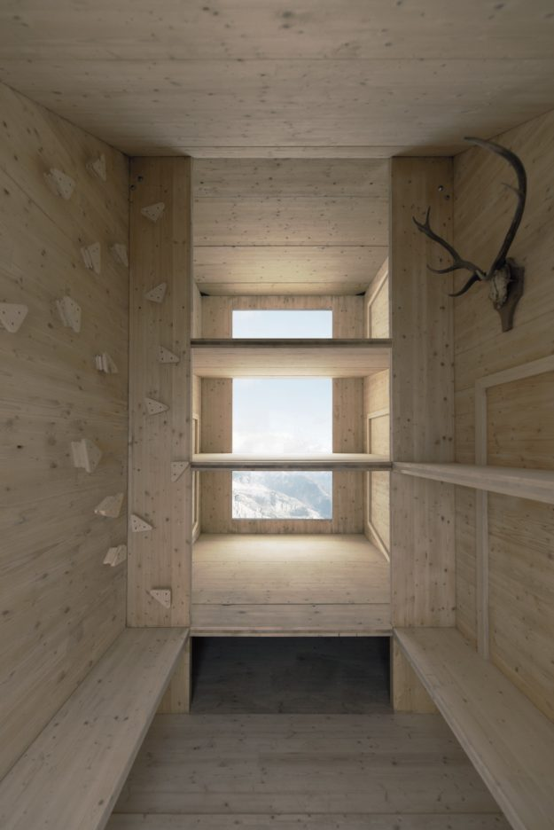 An interior view of the cabin with the alps in the background.