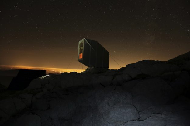 The stunning cabin as seen at night.