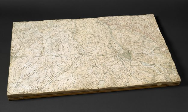 A new exhibition in London looks at the history of the last century through maps