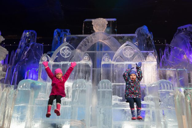 Sisters Scarlett and Zoe from London play with this years breath-taking snow and ice sculptures.