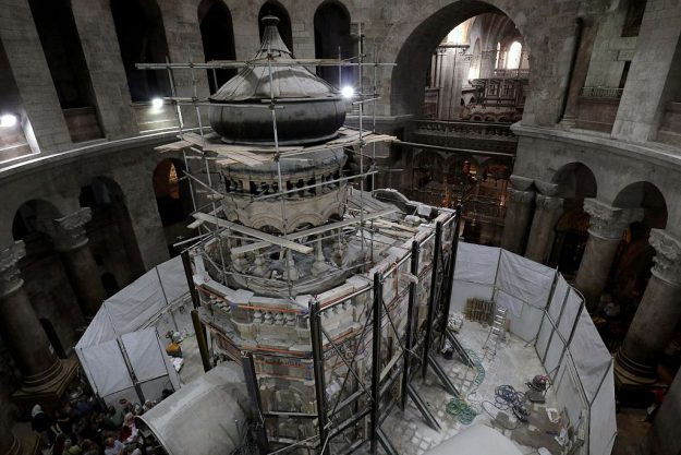 Greek preservation experts work to strengthen the Edicule surrounding the Tomb of Jesus