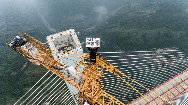Keow and his friend climbed a 740-metre high crane on top of the world's largest bridge to get the photograph.