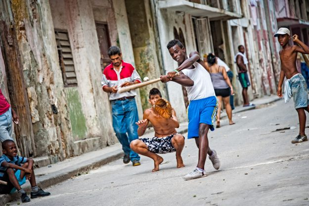 Youths playing baseball on street in Havana, Cuba. Image: Witold Skrzypiński
