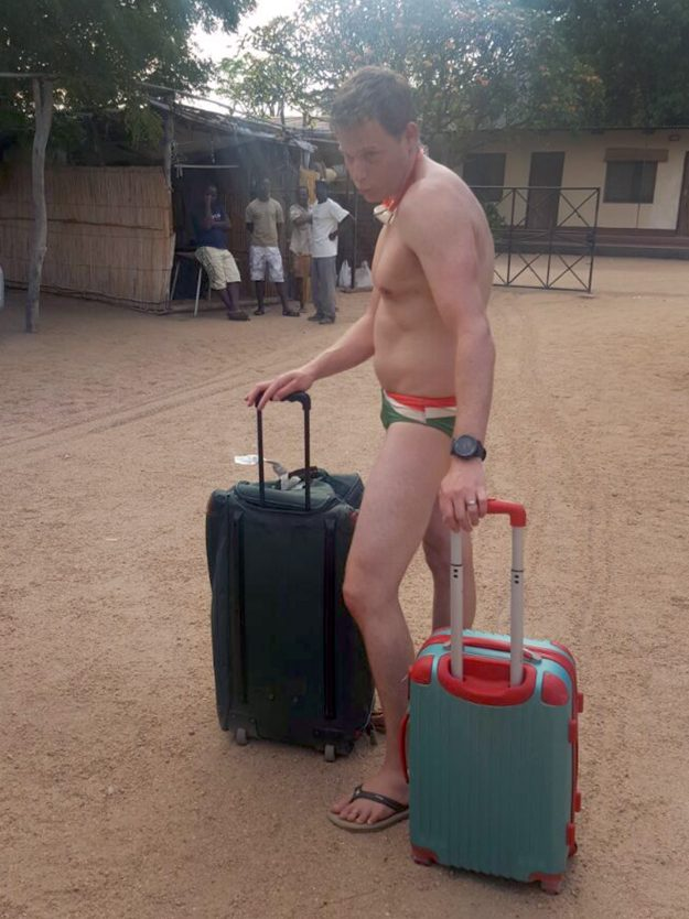 Greig Bannatyne checked in wearing nothing but Speedos and a pair of flip-flops for a South African airways flight at Malawi airport. Image: Caters News