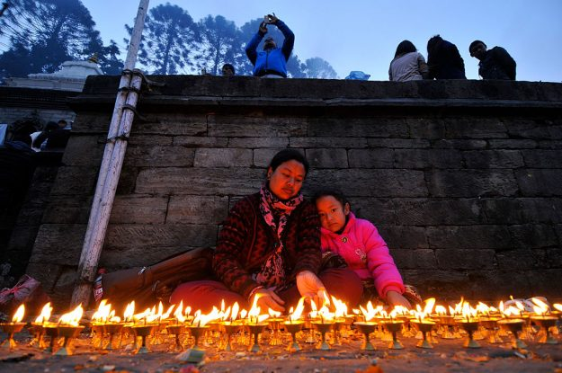 The candles are dedicated to pilgrims' deceased loved ones.